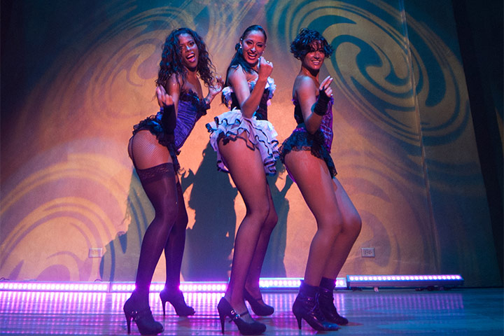 Three dancers in burlesque costumes at Kinky Night Club at Hotel Oasis Cancun Lite