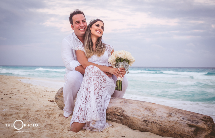 Married couple in front of the beach wedding photo shoot