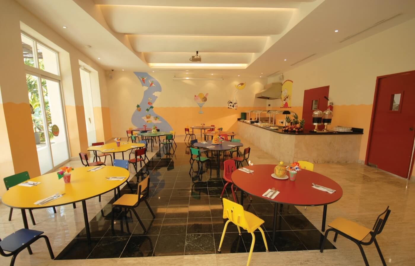 Playground at KiddoZone with consoles and puff armchairs at Grand Oasis Palm Hotel