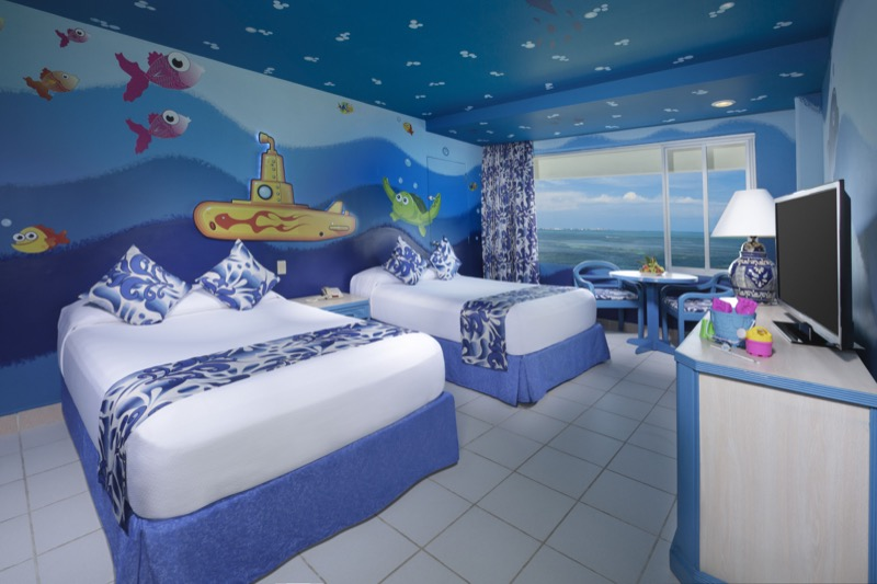 Family Suite with two double beds and underwater theme decoration for children and family in Grand Oasis Palm Hotel.