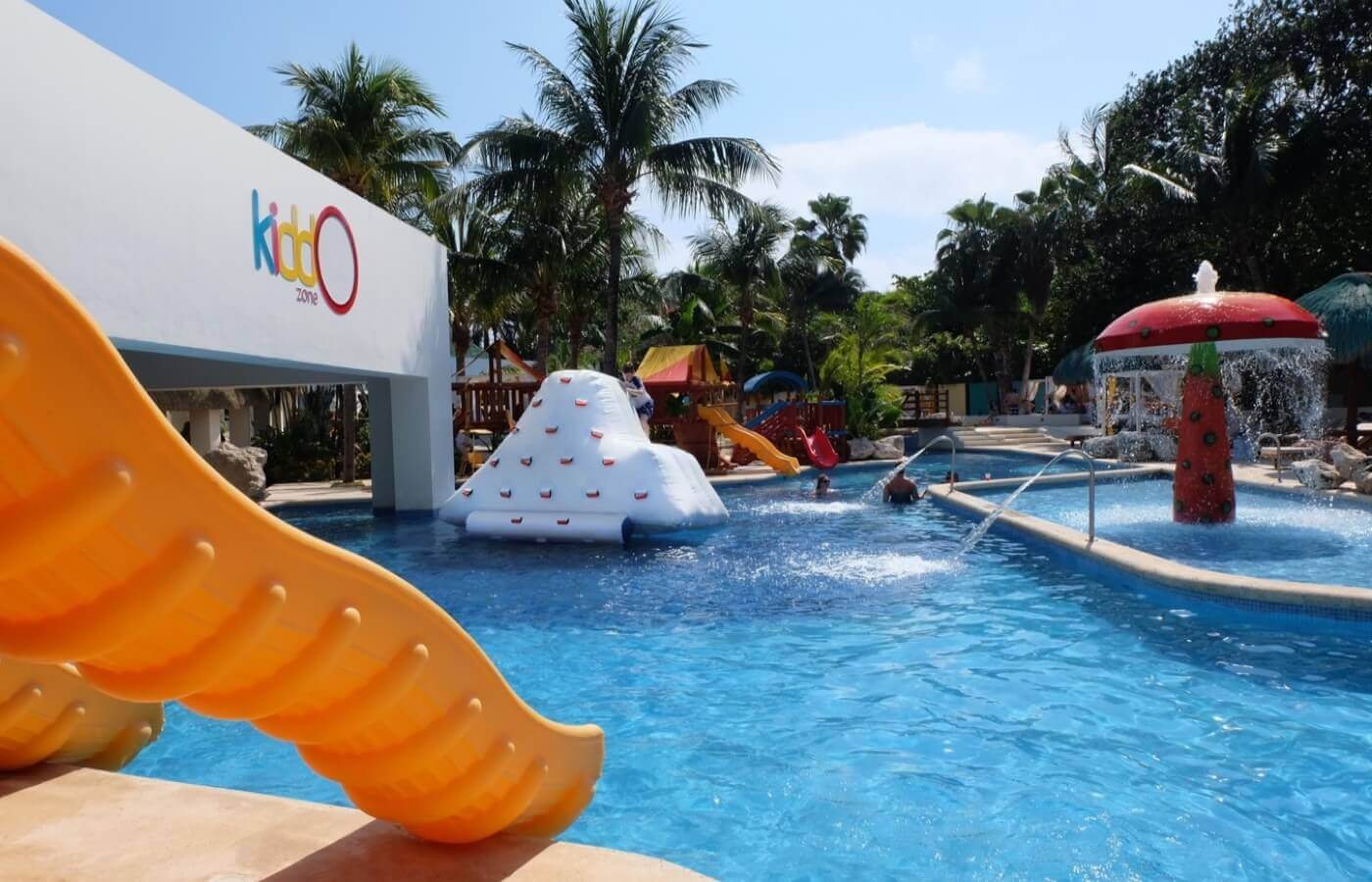 Pool area with KiddoZone games at Hotel Grand Oasis Tulum