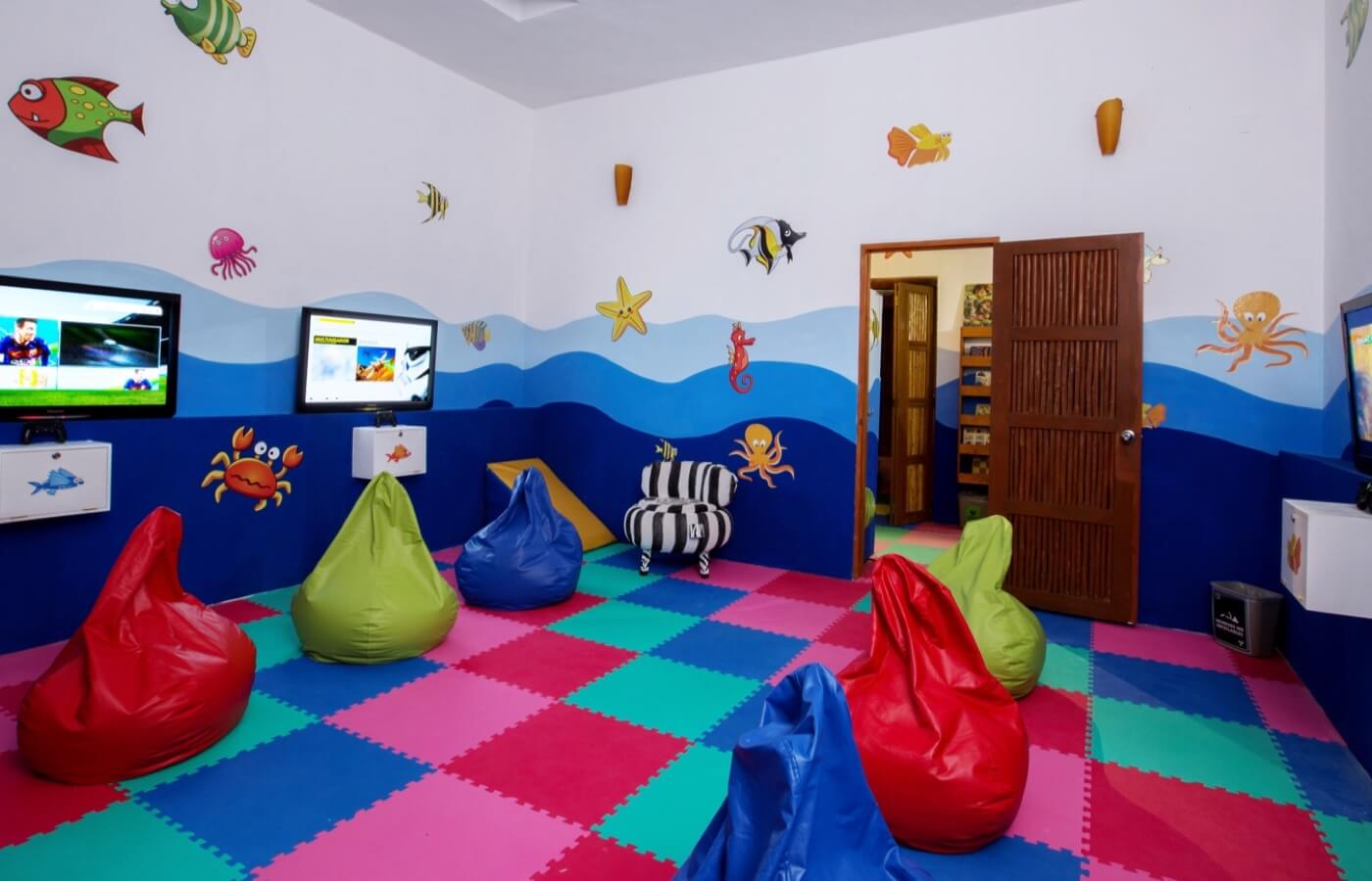 Playground with KiddoZone puff toys and armchairs at Grand Oasis Tulum Hotel