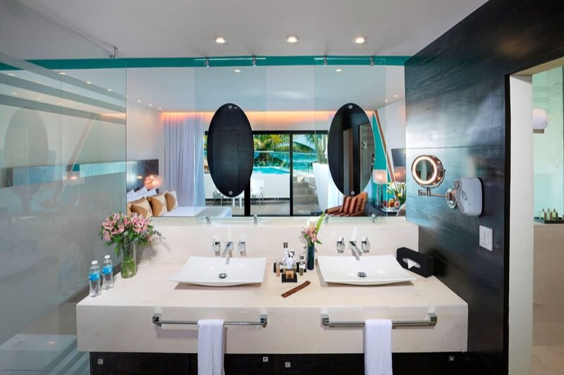 Presidential Room Bathroom with double sink, large mirror and amenities at The Sian Ka'an at Grand Tulum Hotel
