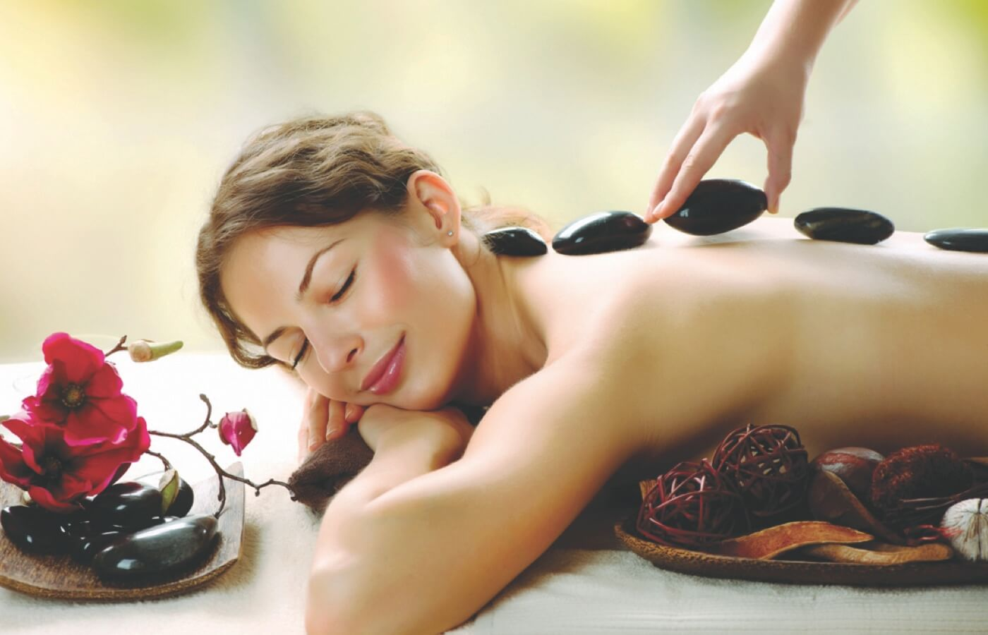 Woman enjoying relaxing massage with stones