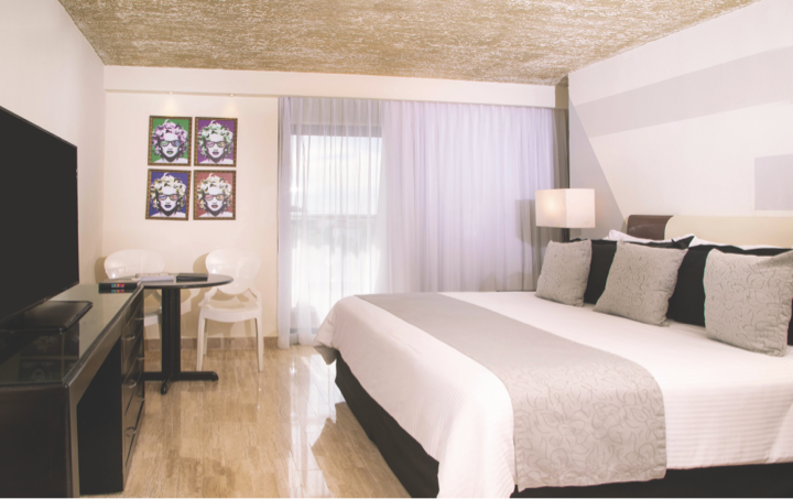 Standard Room with King Size bed decorated in gray, red, black and white in Oh! The Urban Oasis Hotel