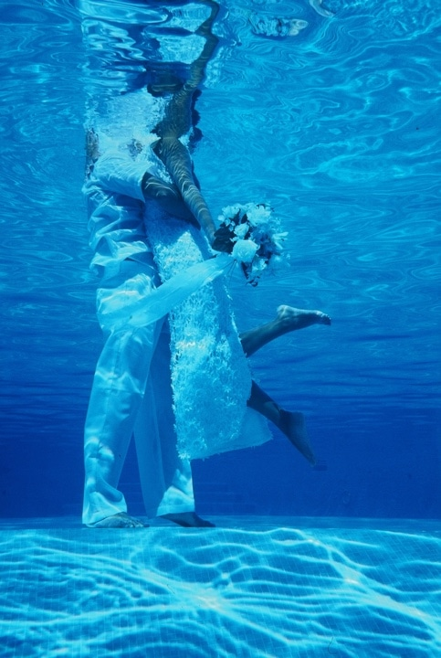 Blue underwater photo shoot for bride and groom