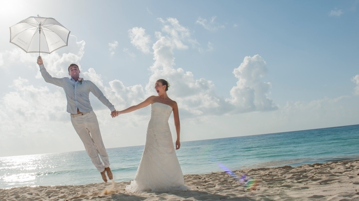 Bride and groom in a fun beachfront photo shoot